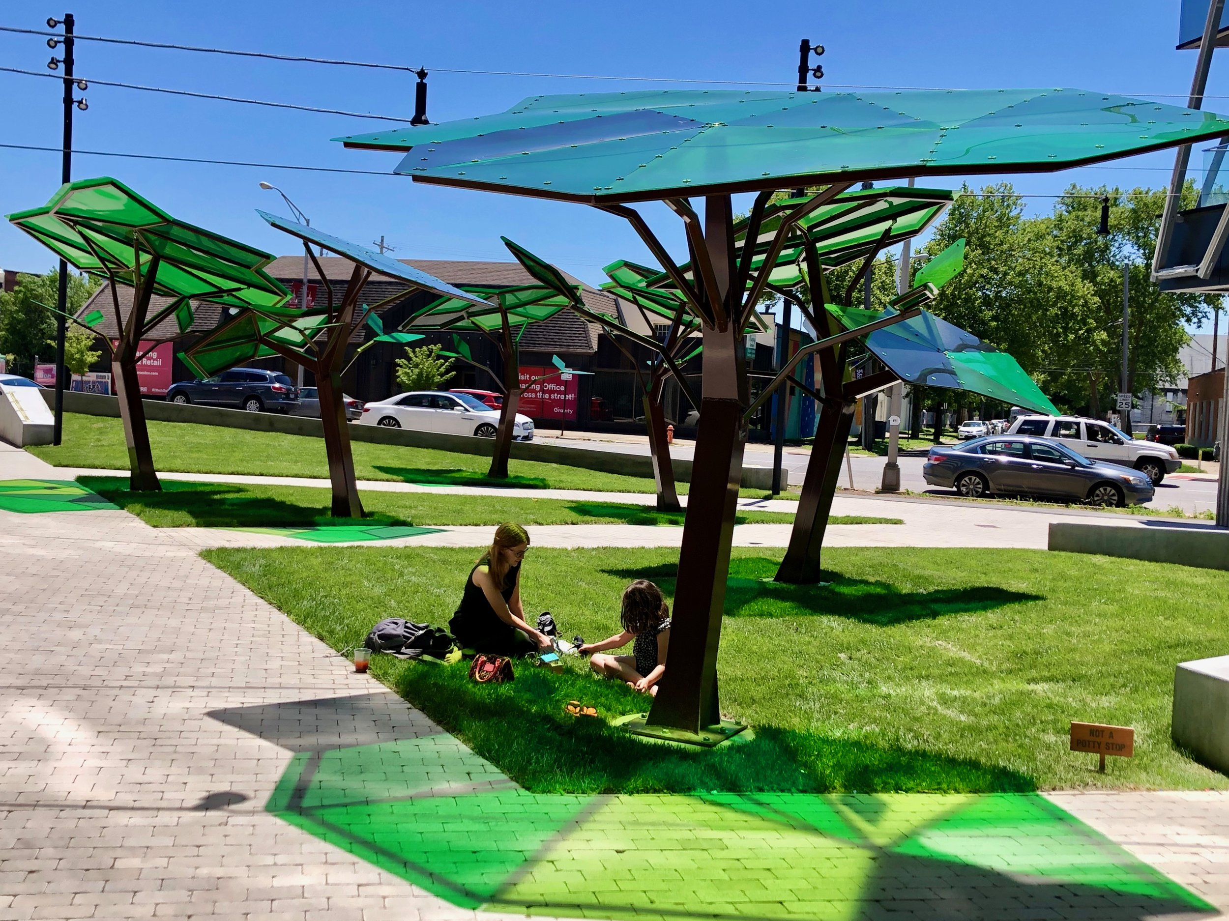 Tree sculptures that provide shade and play