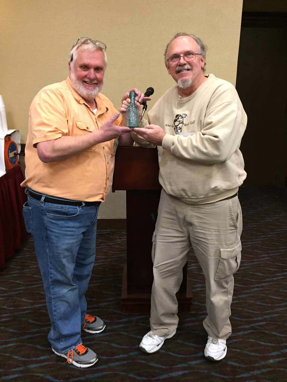 Raffle Ticket chair Richard Matthies (right) giving Tom Majewski his prize for selling the most raffle tickets.