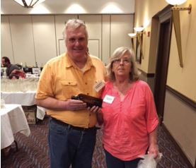 Linda Dishno giving Tom Majewski his prize for selling the most raffle tickets.