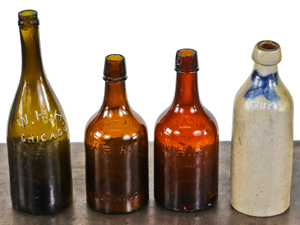 W.H.H. Grouping: olive green ring top quart, two quart ales and a 12 sided Merrill Patent stoneware bottle**