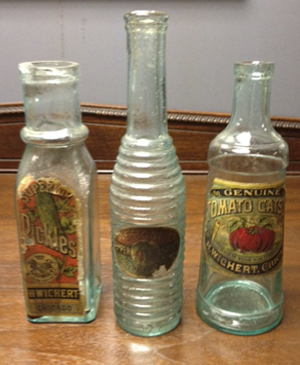 Paper labeled, glass product bottles from H. Wichert