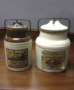 Paper labeled, pottery product containers from John Sexton & Co.