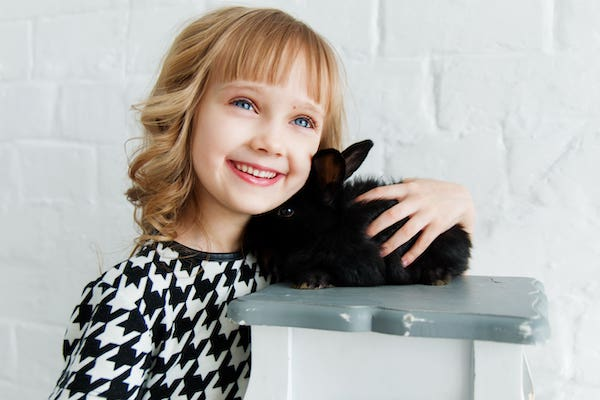 SEGALL-child-with-bunny-smiling-child-therapy-min.jpg