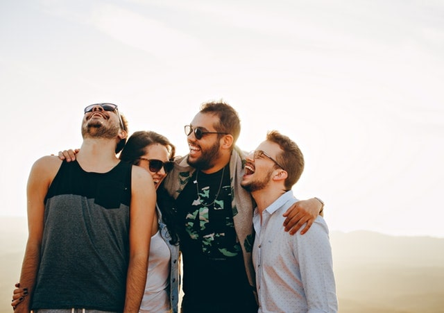 SEGALL-friends-a-top-mountain-smiling-min.jpg