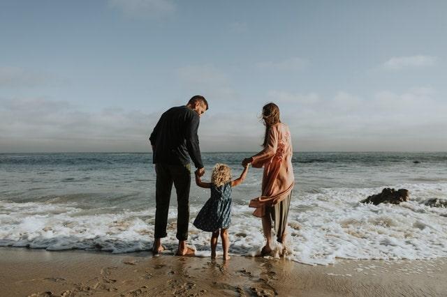 SEGALL-family-happy-at-beach-ocean-waves-min.jpg