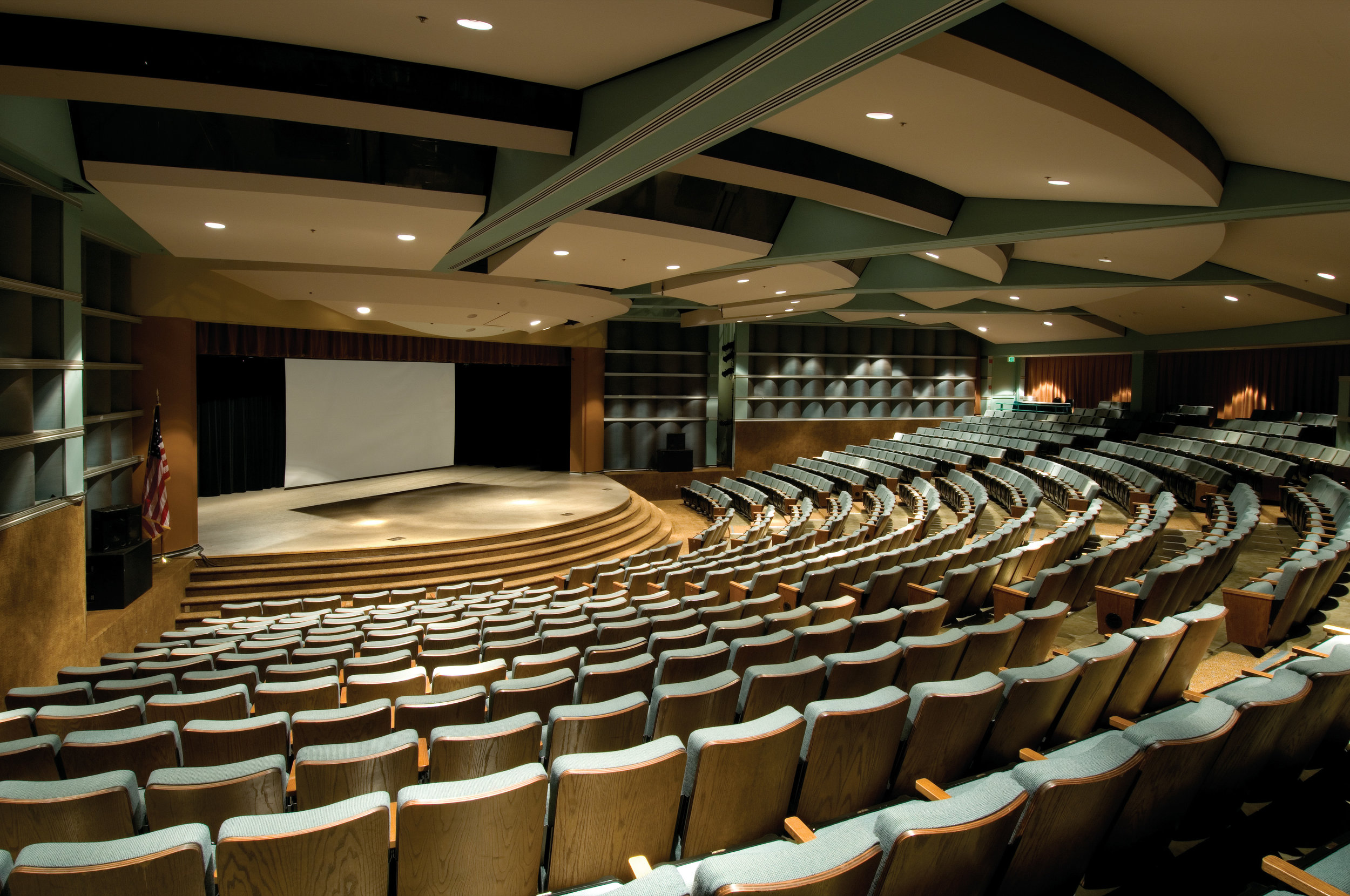 Theater showing 600 empty seats and stage