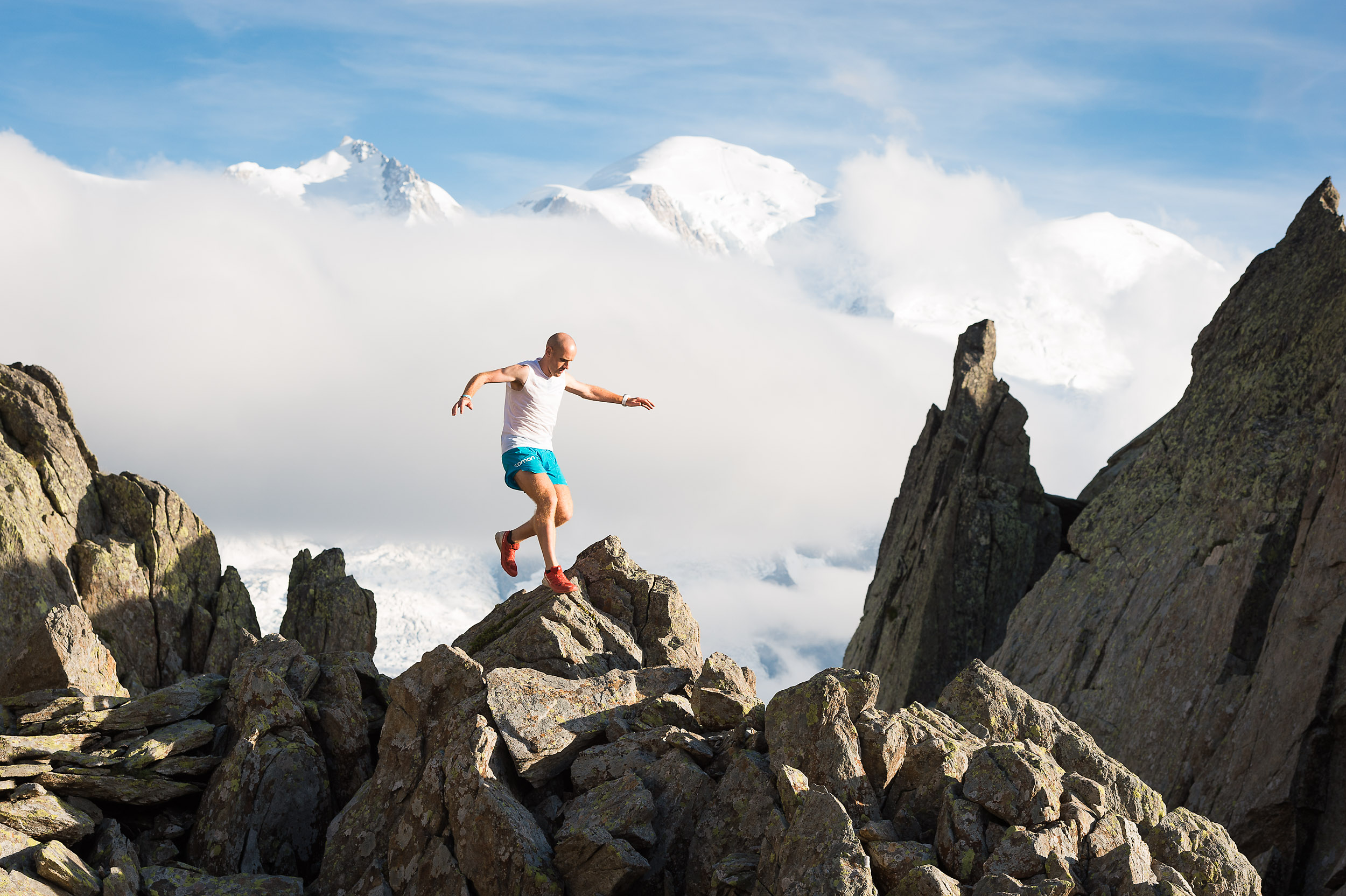 Athlete Donnie Campbell mountain running near Le Brévent, Chamonix, with Mont Blanc in the background