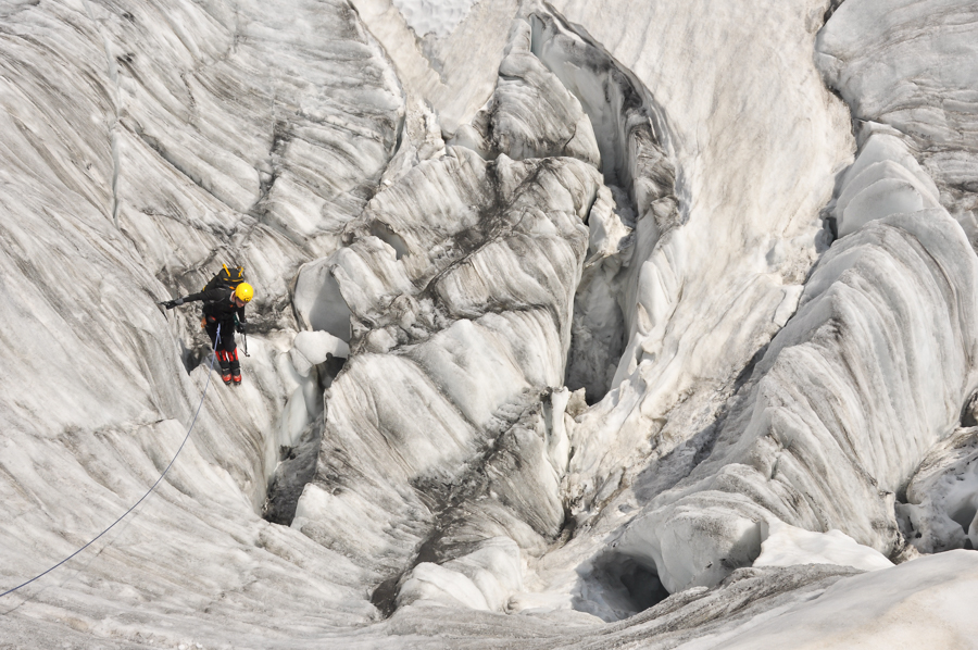 Alex Haken checking out a crevasse on the Tour Glacier near the Albert Premier (1er) refuge in the French Alps