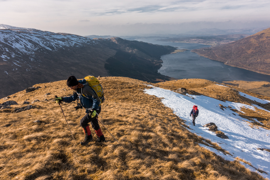Alaskan-based adventure photographer Dan Bailey and David Hetherington ascend the lower slopes of Beinn Sgulaird, a Munro in the West Highlands of Scotland