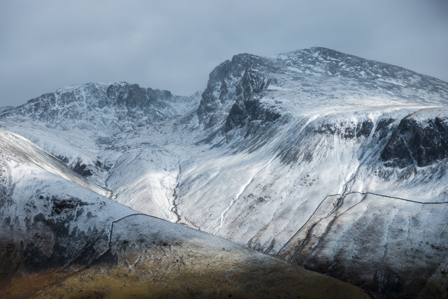 Black cliffs on the Scafell Pike mountain in winter in the English Lake District