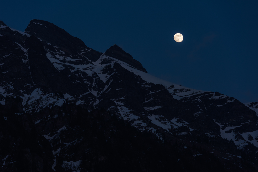 An almost full moon rises above the slopes near the summit of Männlichen, a 2343m high peak in the Swiss Alps. Captured with the aid of a Joby Focus Tripod.