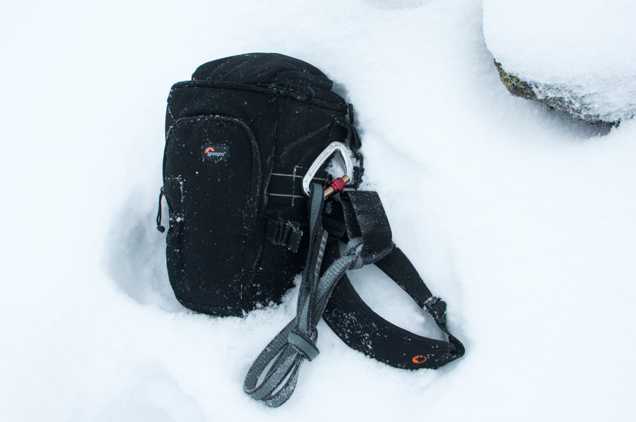 My Lowepro Toploader Pro 75 AW camera bag in the snow near the summit of Beinn Sgulaird, a Munro in the West Highlands of Scotland