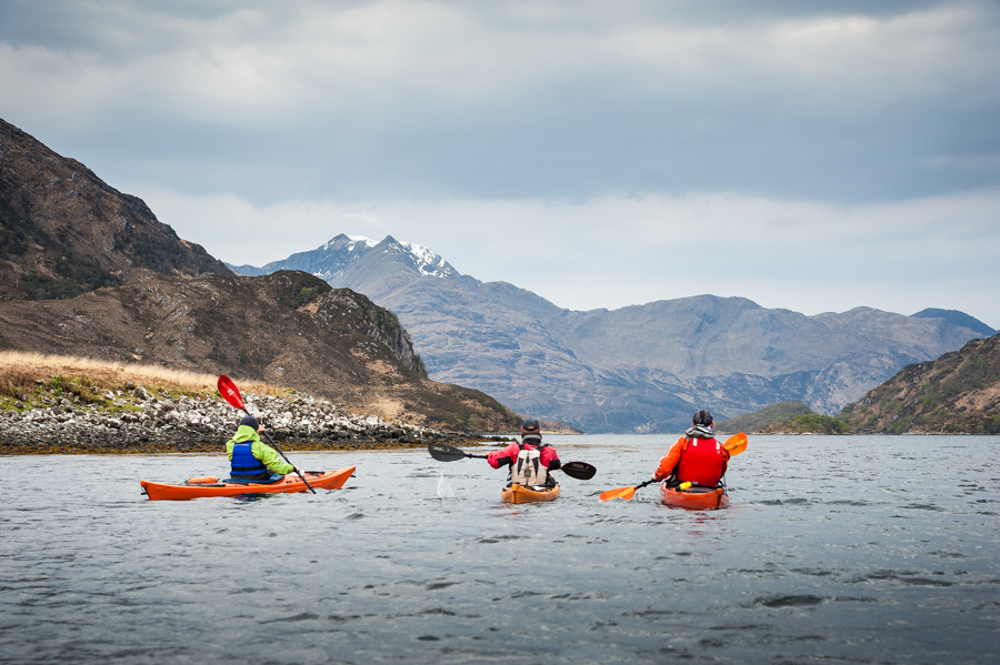Paddling Loch Hourn with the summit of Ladhar Bheinn in the distance