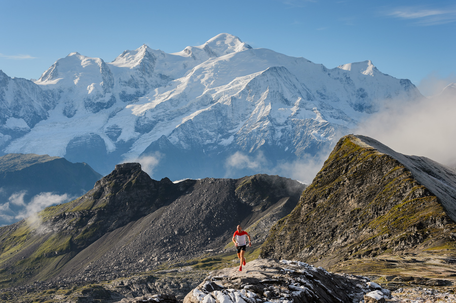 Donnie Campbell running on Desert de Plate with Mont Blanc in the background