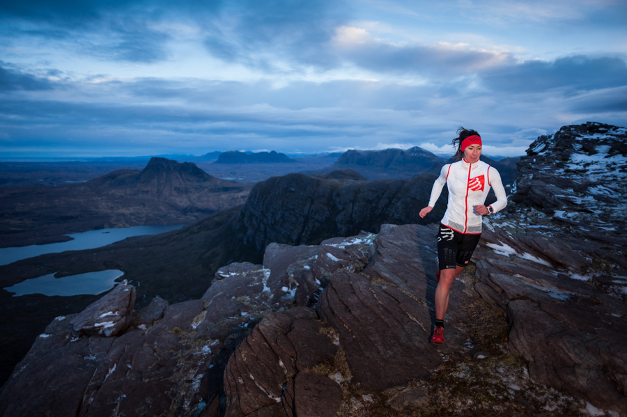 Joanne Thom running at dawn near the summit of Sgurr an Fhidhleir in the North-West Highlands of Scotland