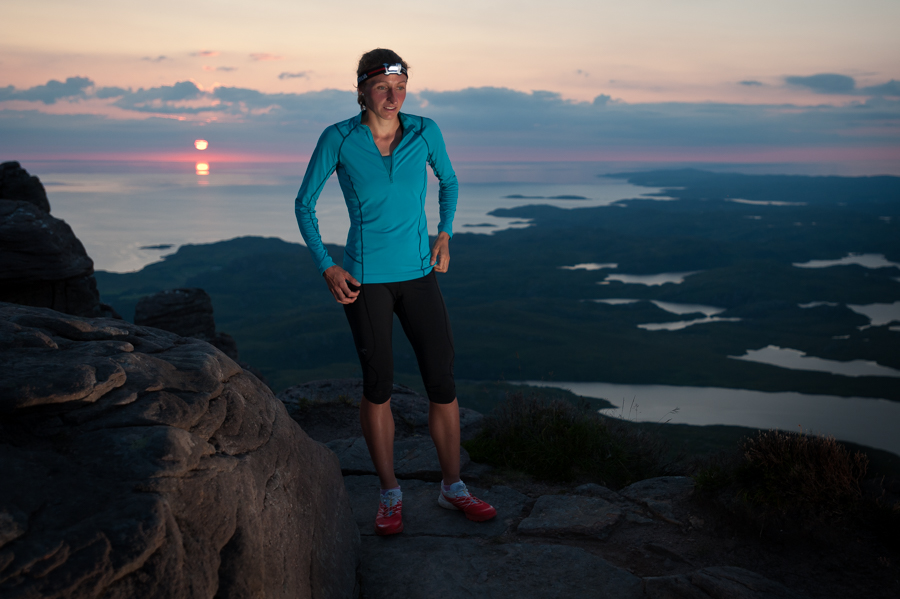 Tessa Strain near the summit of Stac Pollaidh at sunset in the North-West Highlands of Scotland