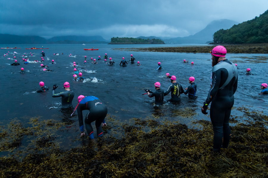 Competitors preparing to enter the cold water of Loch Shieldaig at dawn for the 3.8km tidal swim leg of the Celtman Extreme Scottish Triathlon