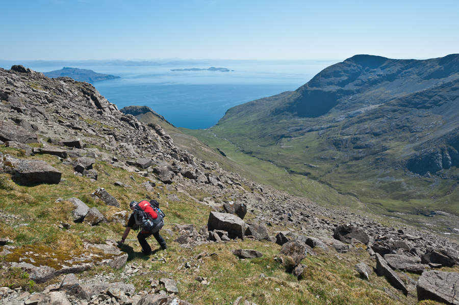 Bill Snee descending from the summit of Askival towards Dibidil Bothy in the Isle of Rum, West Highlands of Scotland