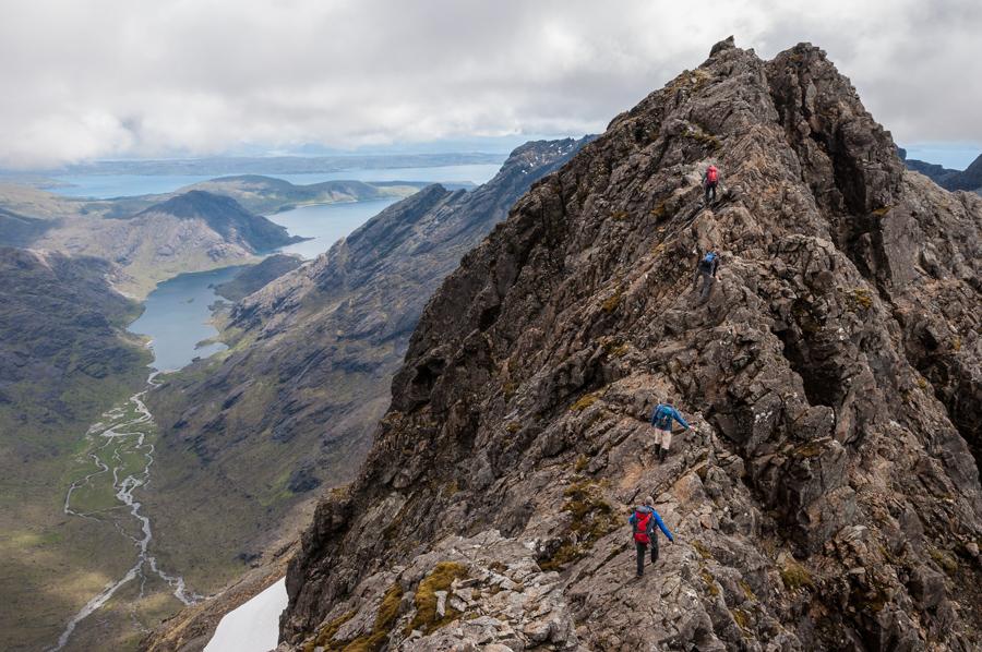 Scrambling over Sgurr a'Ghreadaidh on a traverse of Sgurr a'Mhadaidh to Sgurr na Banachdaich in the Black Cuillin on the Isle of Skye in the West Highlands of Scotland
