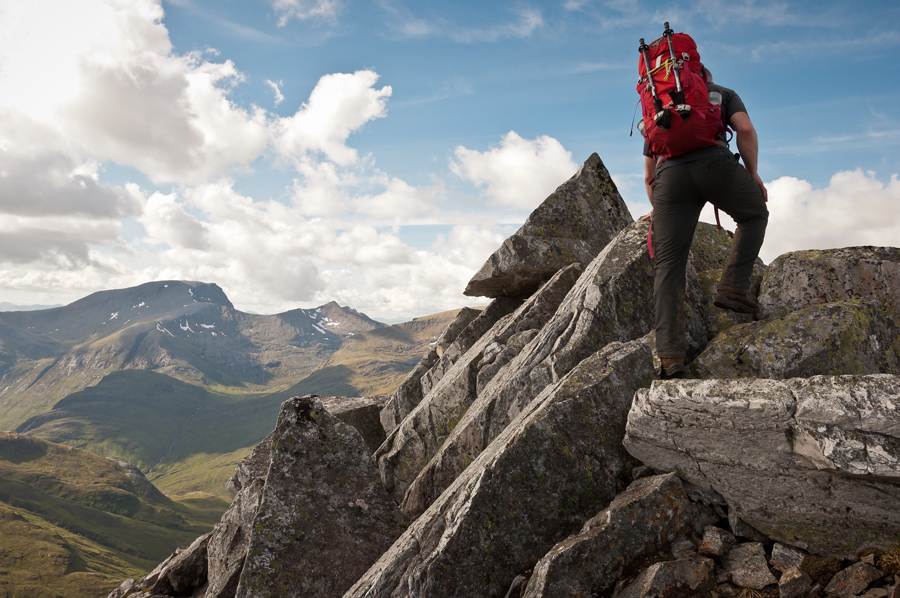 David Hetherington on the summit ridge of Binnein Mor in the Mamores with the summit of Ben Nevis in the distance.