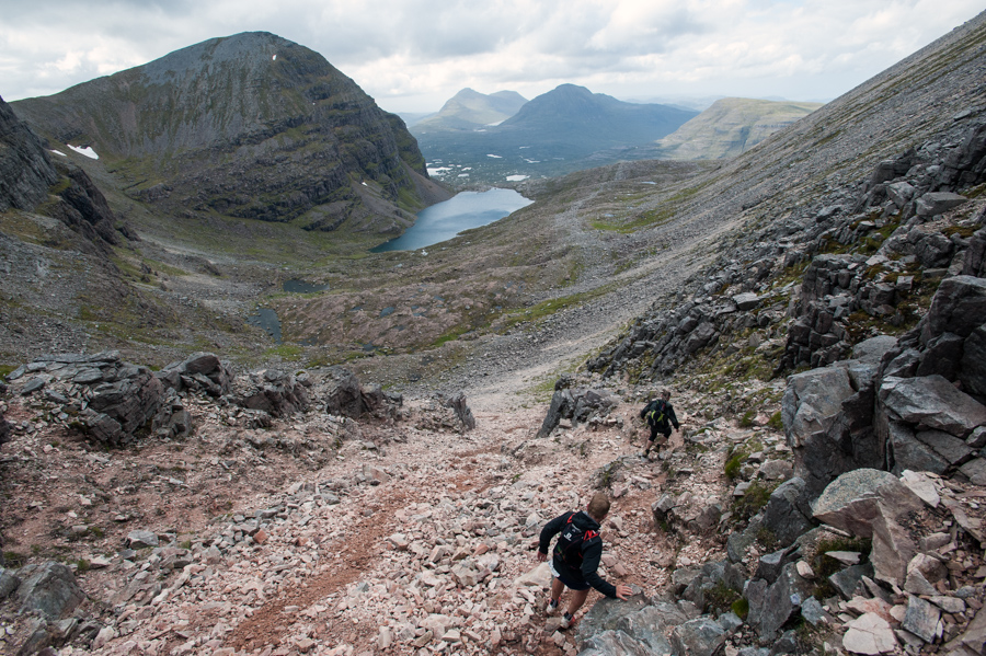 Thor Hesselberg (foreground) and support runner Ryan Maclean descending the scree gully on Beinn Eighe during the 42km running leg of the Celtman Extreme Scottish Triathlon
