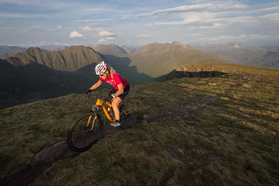 Naomi Freireich mountain biking on Beinn Alligin in the North-West Highlands of Scotland