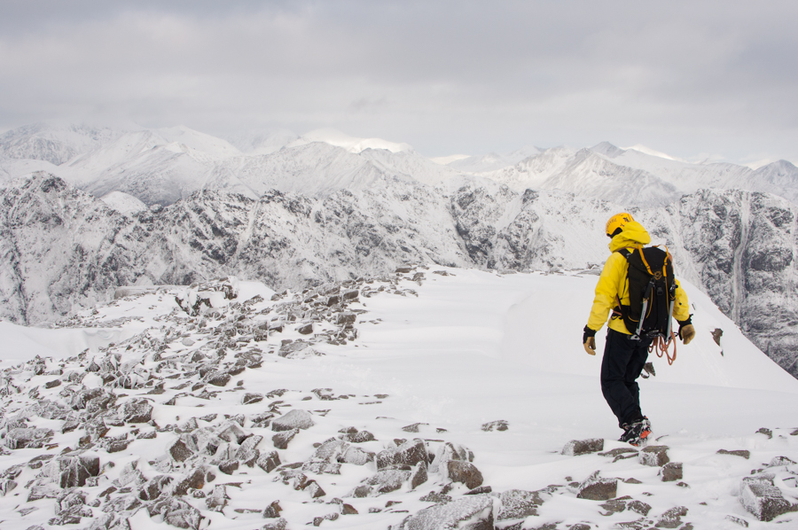 Alex Haken walking off the top of Stob Coire nan Lochan after an ascent of Dorsal's Arete in the West Highlands of Scotland