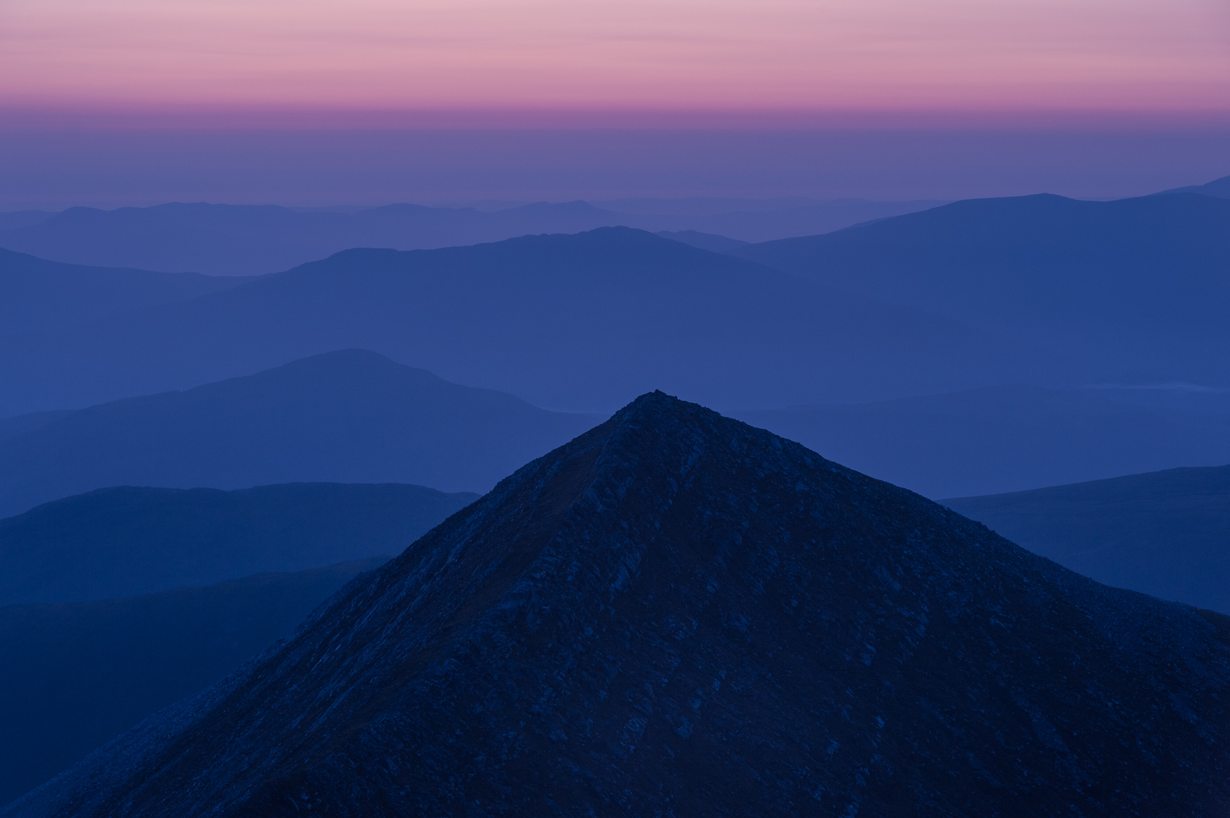 Dawn light over Stob Coire na Ceannain from a bivvy on Stob Choire Claurigh in the Grey Corries, West Highlands of Scotland.