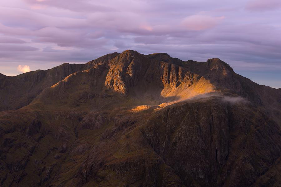 Stob Coire nan Lochan on the Munro, Bidean nam Bidean, at dawn in Glen Coe, Scotland.