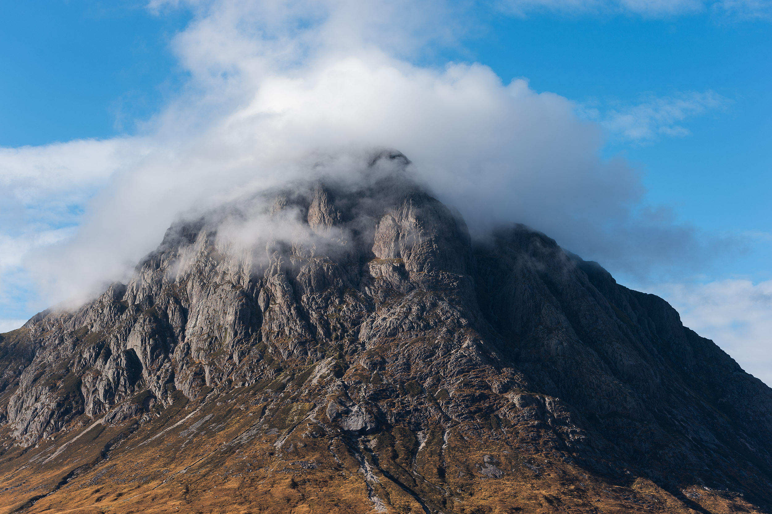Clouds cover the summit of Buachaille Etive Mor (the 'big herdsman of Etive'), a well-known Scottish peak which stands at the entrance to Glen Etive and Glen Coe in the West Highlands of Scotland.