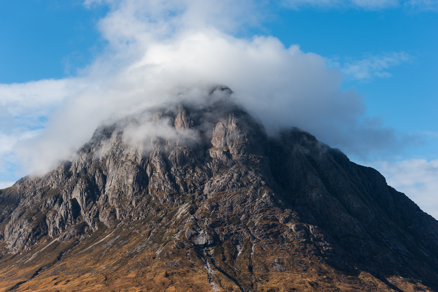 Clouds cover the summit of Buachaille Etive Mor in Glen Coe, Scotland.