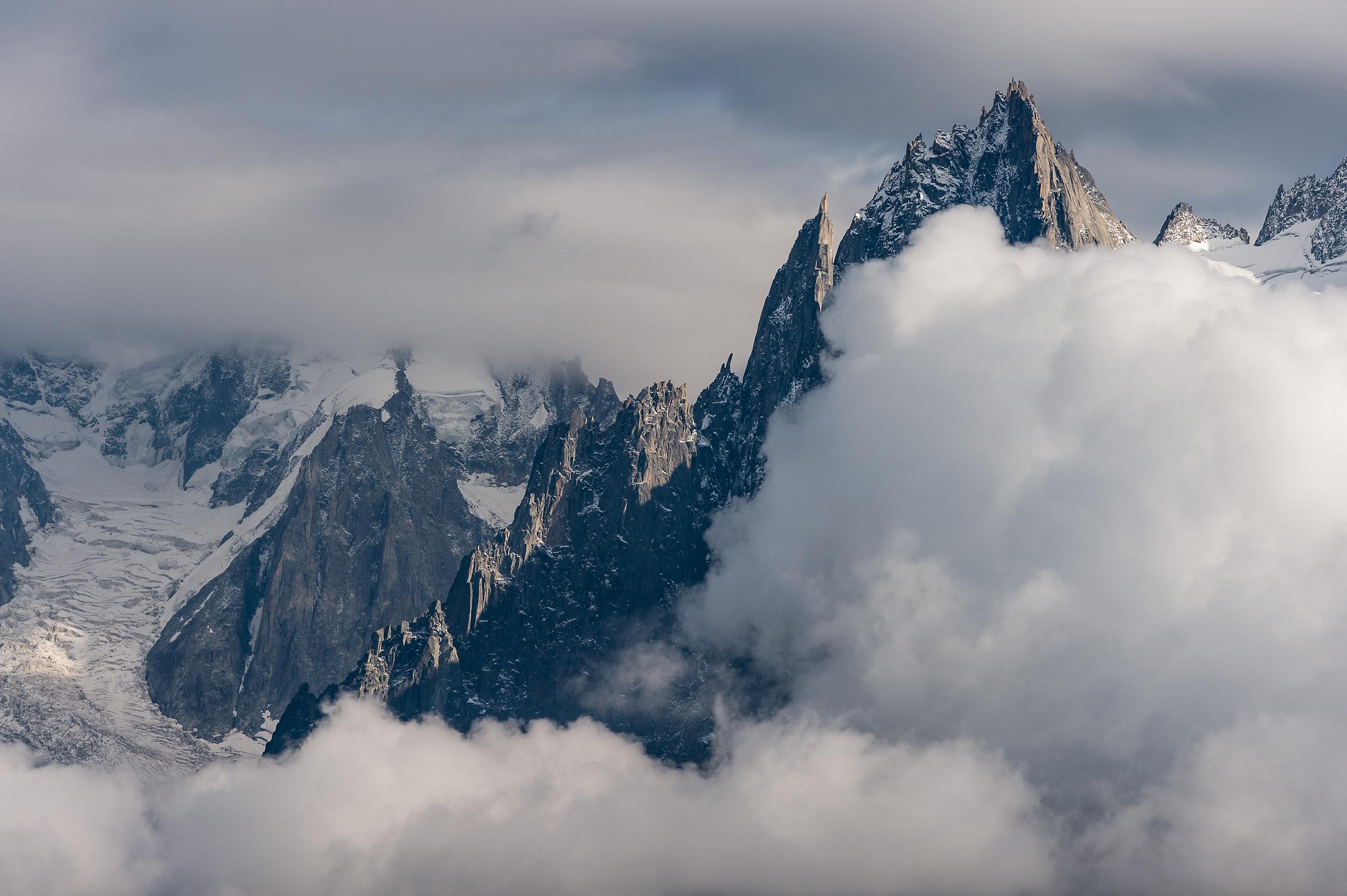 Afternoon clouds approaching the summits of Aiguille de la République and Aiguille des Grands Charmoz above Chamonix, France