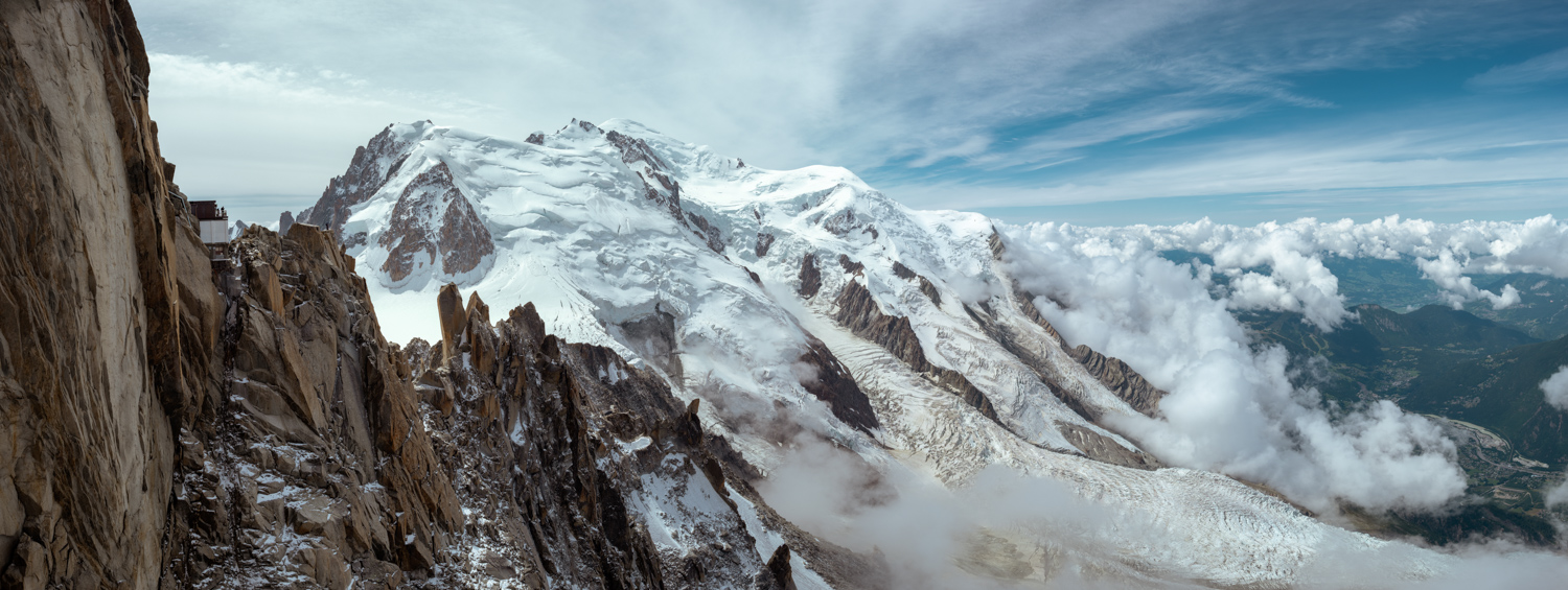 A panoramic view of the French slopes of Mont Blanc and the Bossons Glacier as it drops down into Chamonix in France.