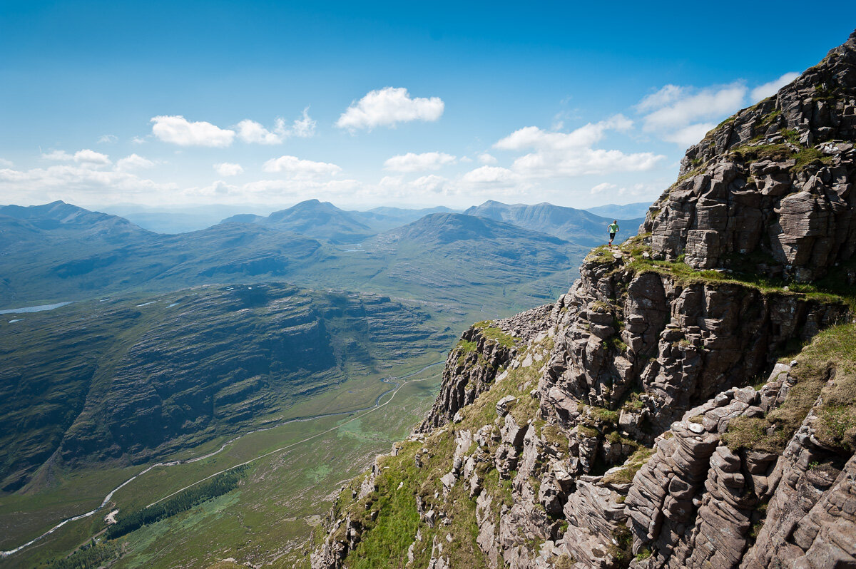 Arc'teryx athlete Tessa Strain running along the balcony path on Liathach, a Munro in the North-West Highlands of Scotland.