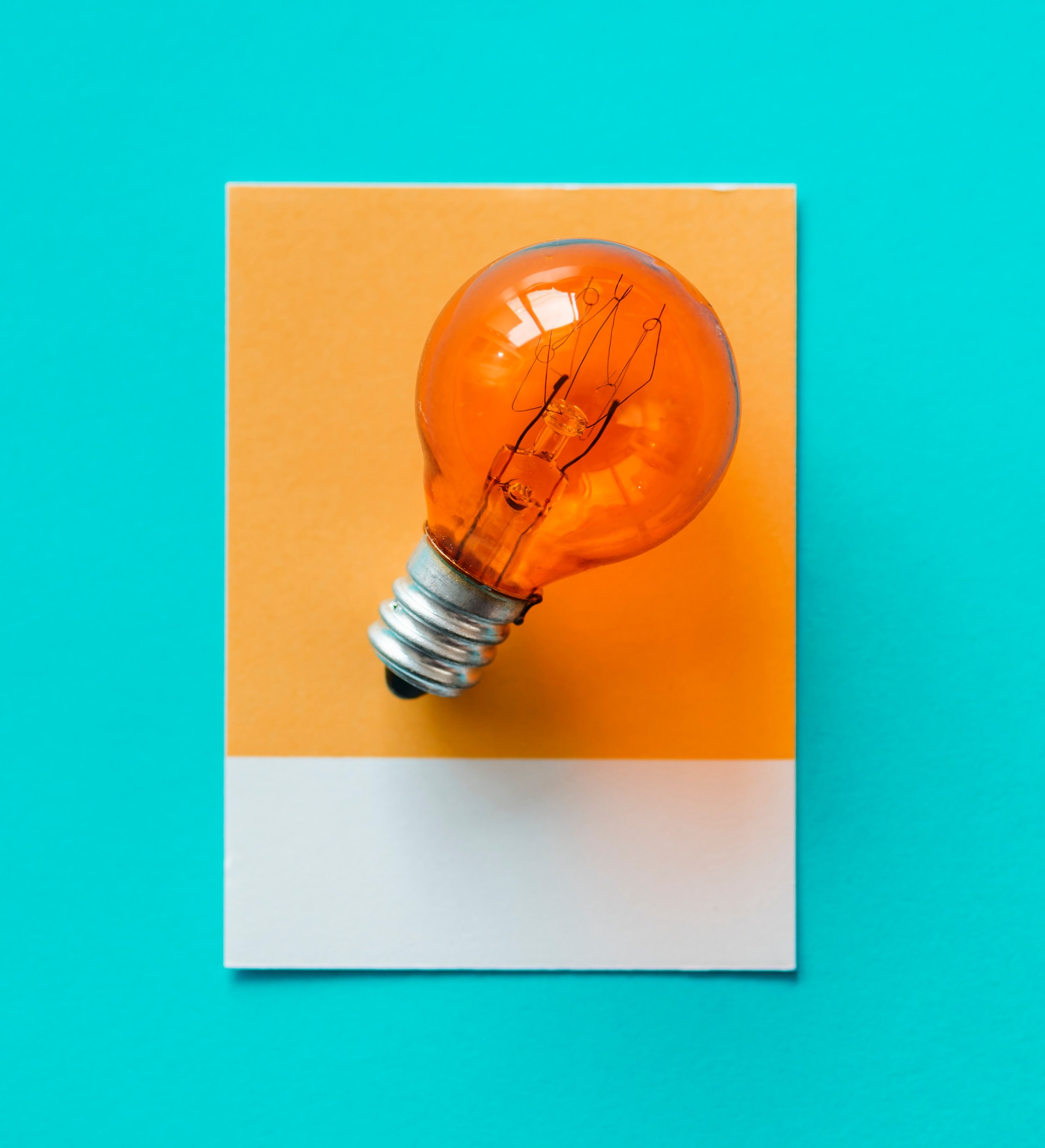 Amber lightbulb on a blue background