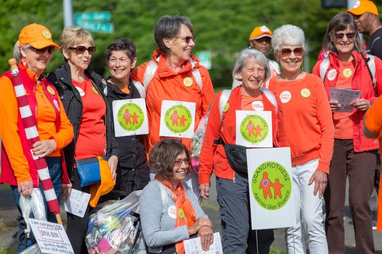 Moms Demand Action on Wear Orange Day in a walk across the I-90 Bridge to bring awareness to Gun Violence Prevention.