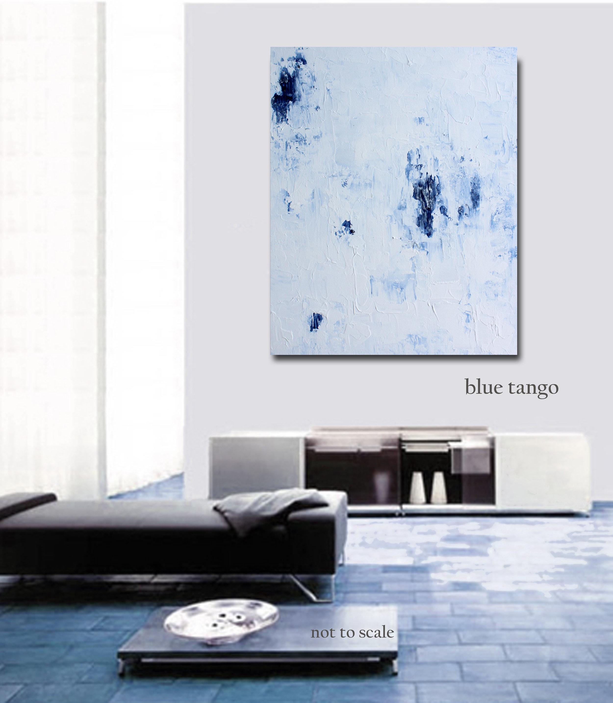 Dark furniture + light-colored art can balance a room.