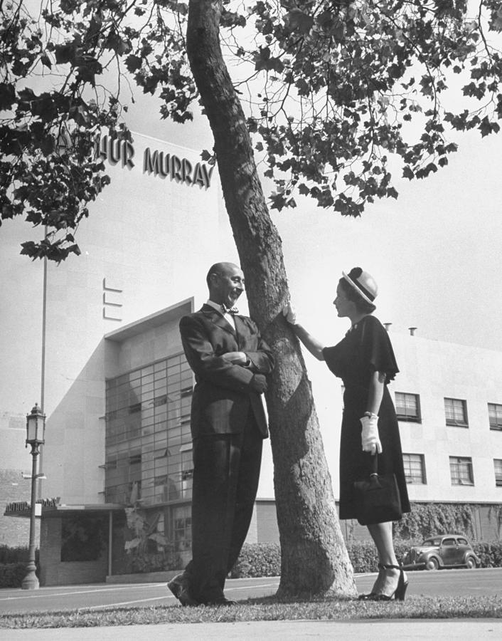Arthur Murray and his wife Kathryn standing outside of their dance studio.