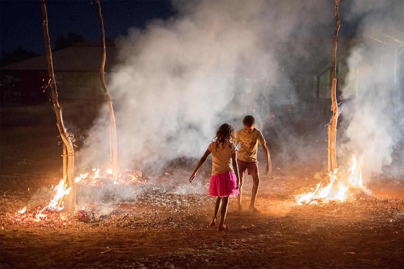 Children dancing amongst the embers (adj 2).jpg