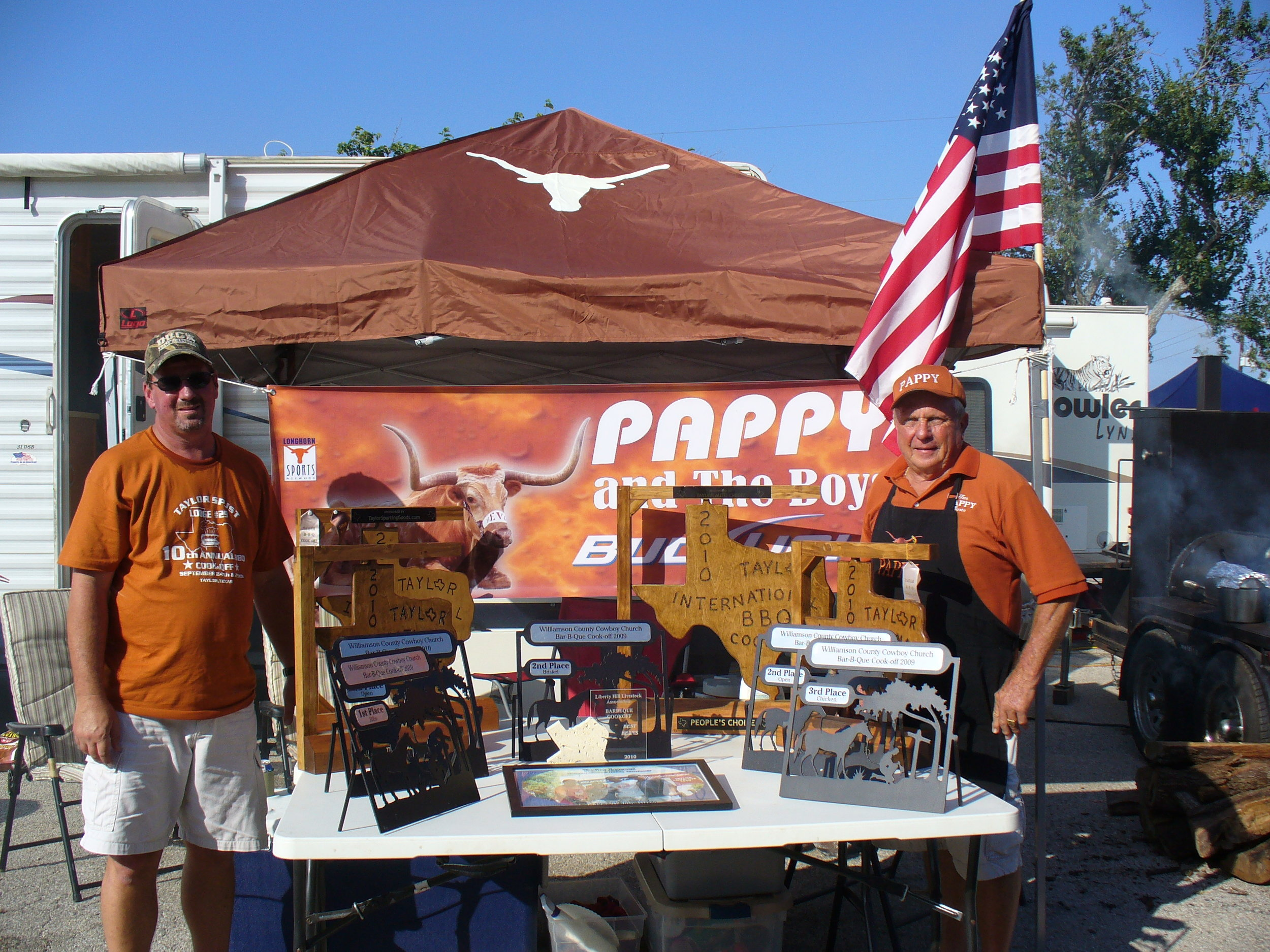 Robin's dad aka Pappy (right) with some of his many BBQ competition trophies.