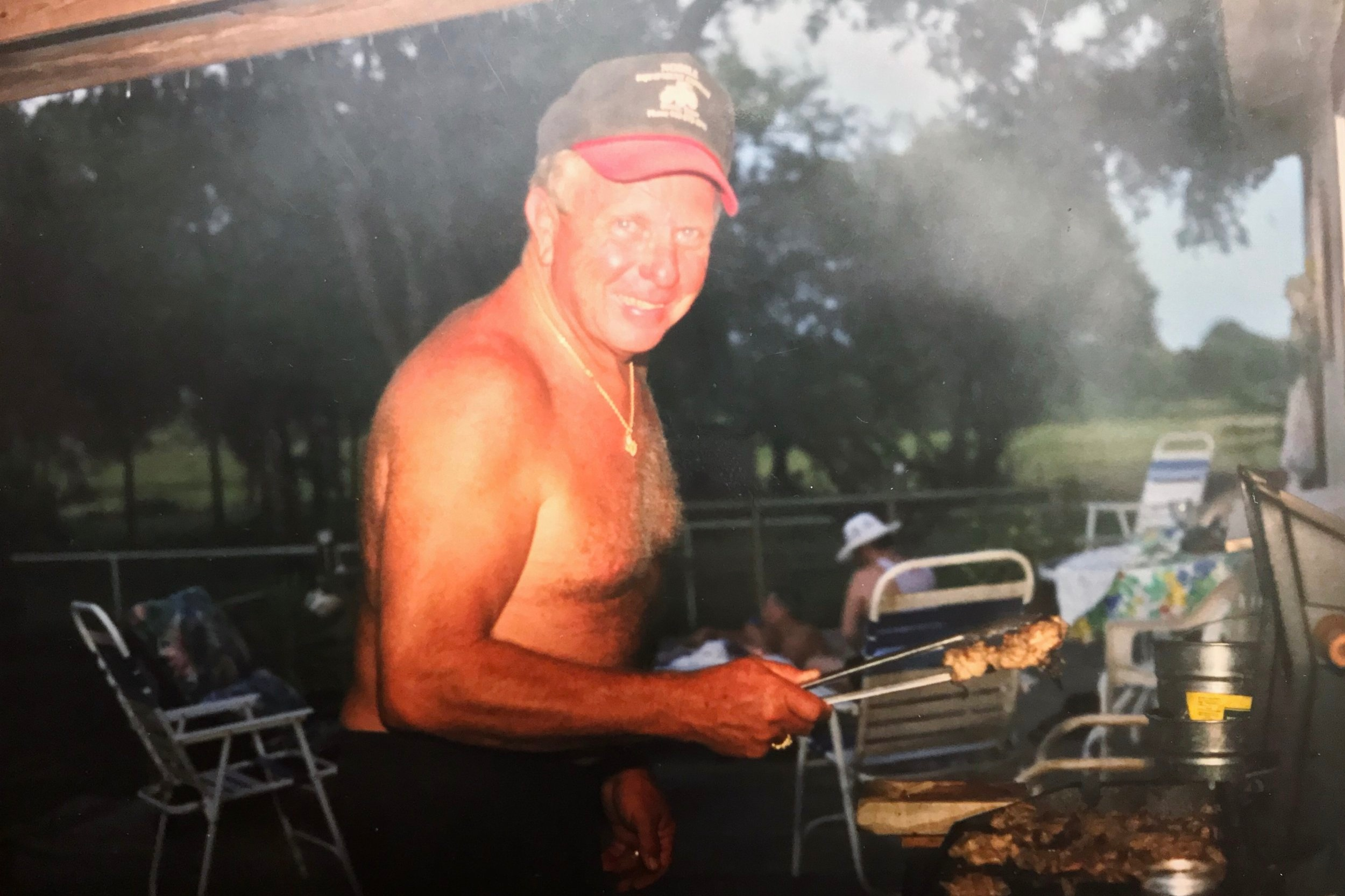 Pappy in his element: cooking for his family under the Texas sun.