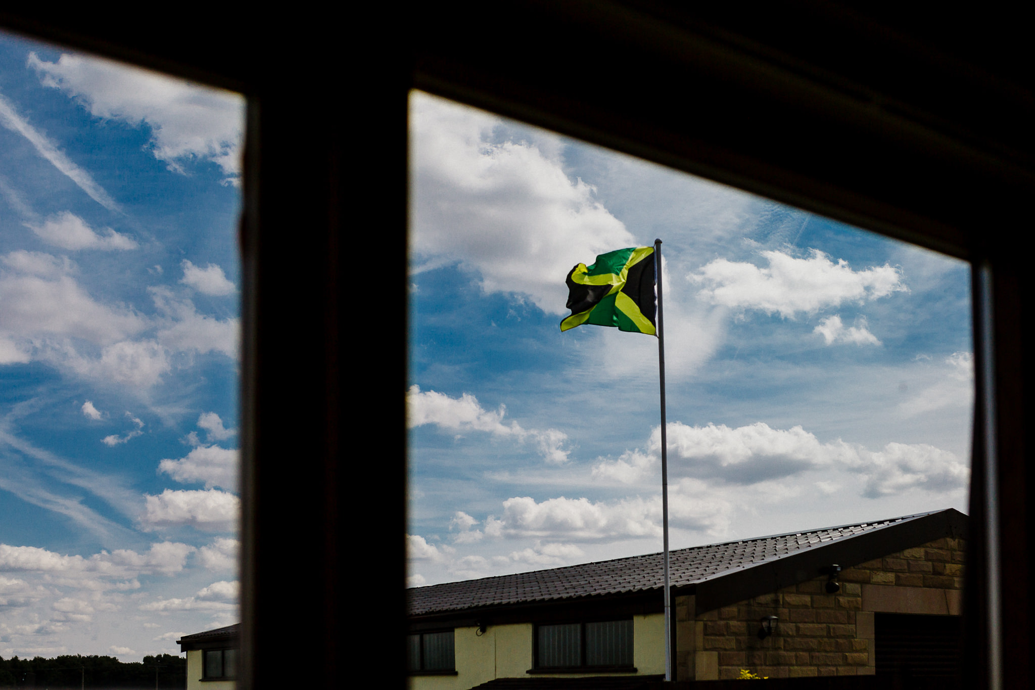 A jamaican flag flies above a yorkshire wedding venue