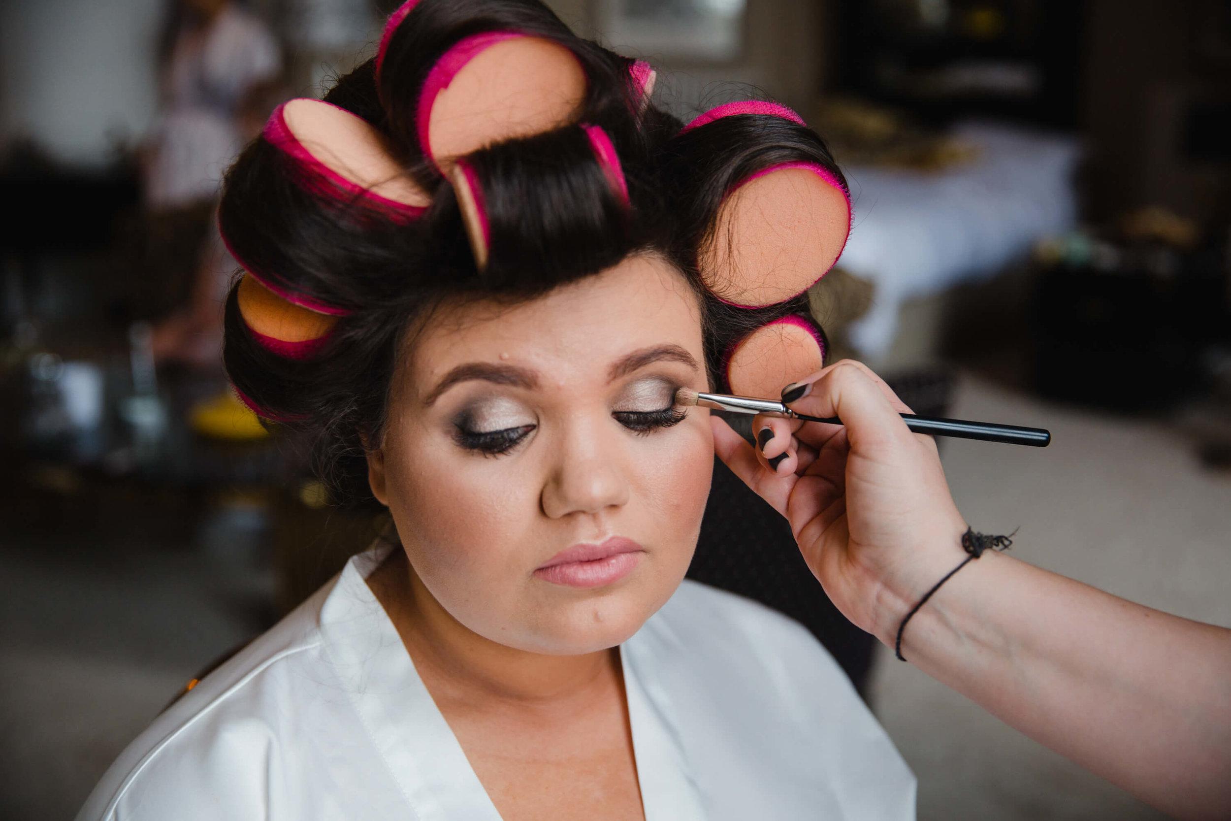 close up of bride having make up applied