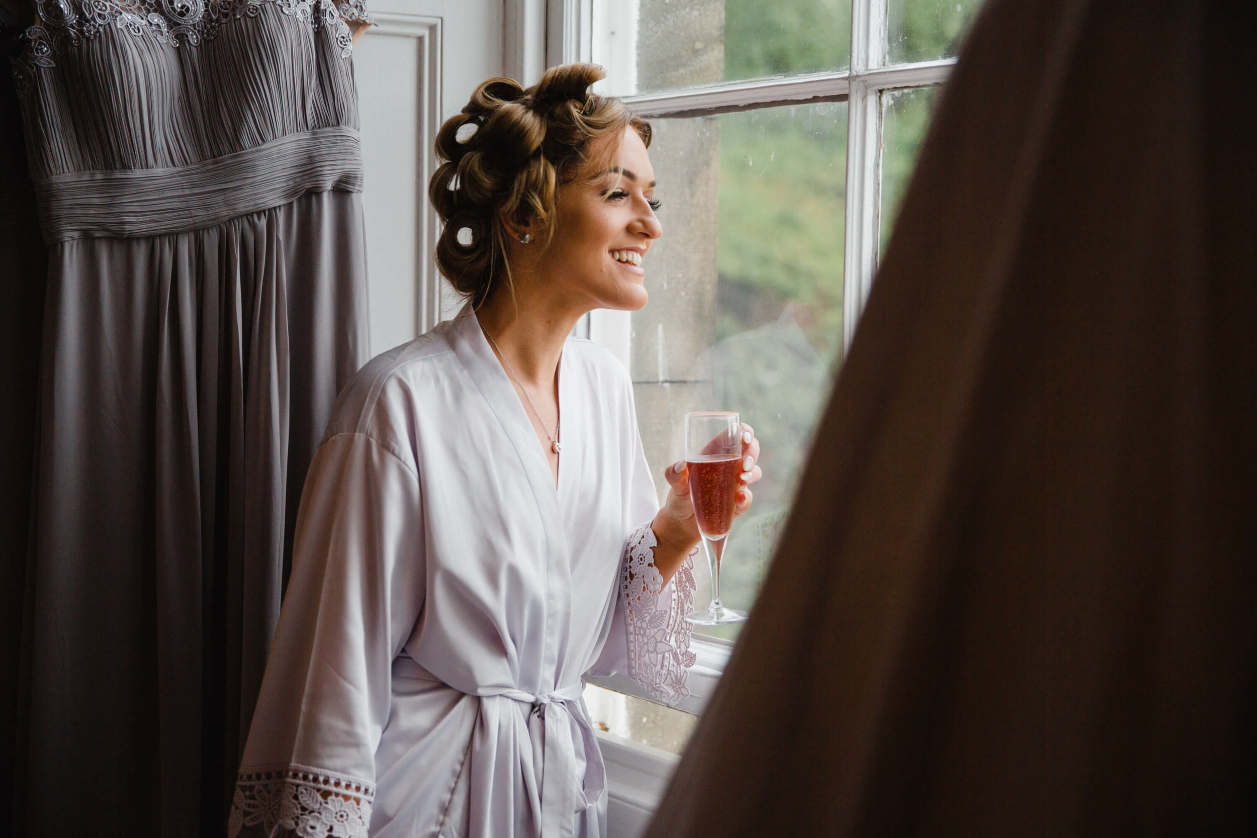 bridesmaid looking out of window at haigh hall