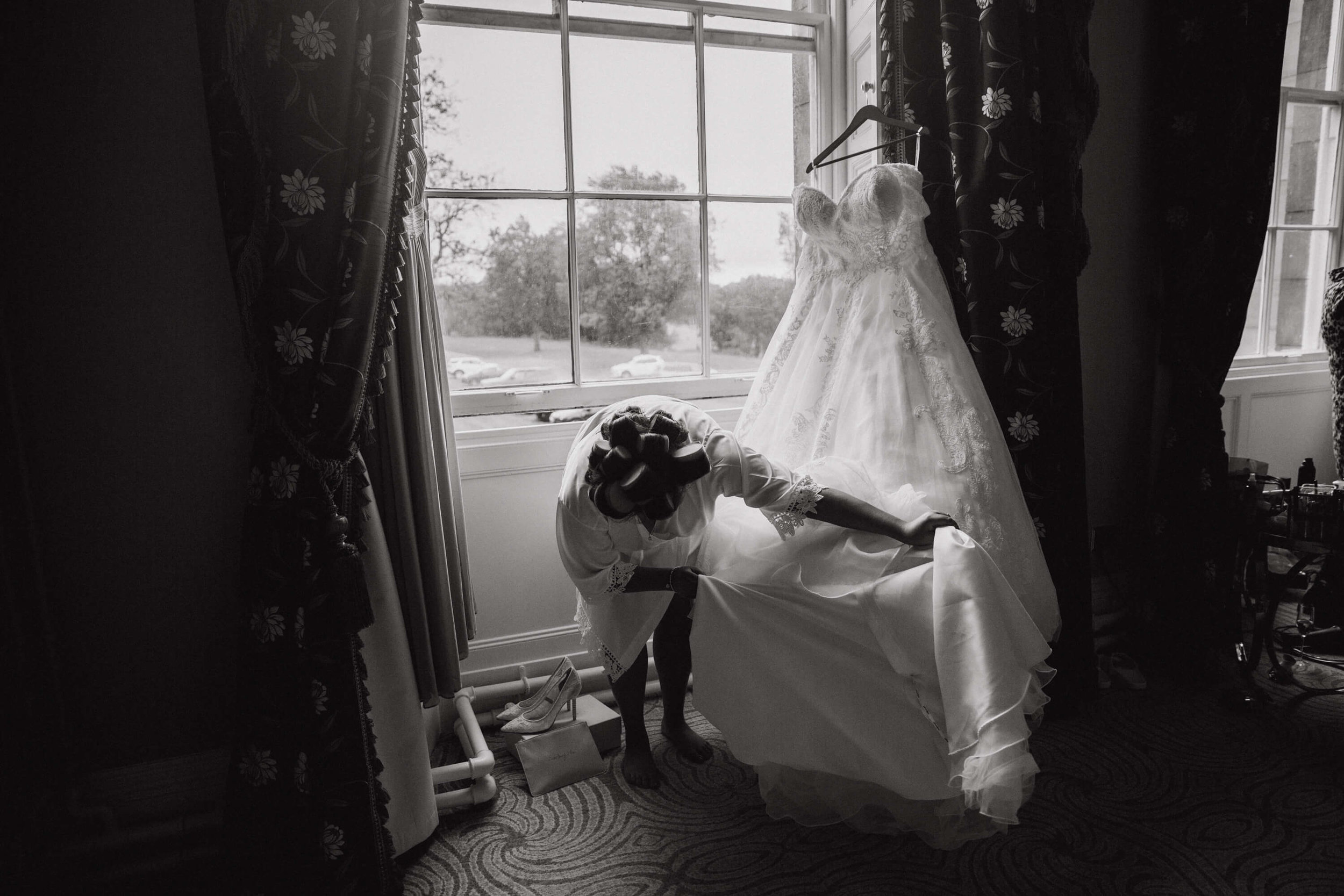 black and white photograph of bride and wedding dress at haigh hall