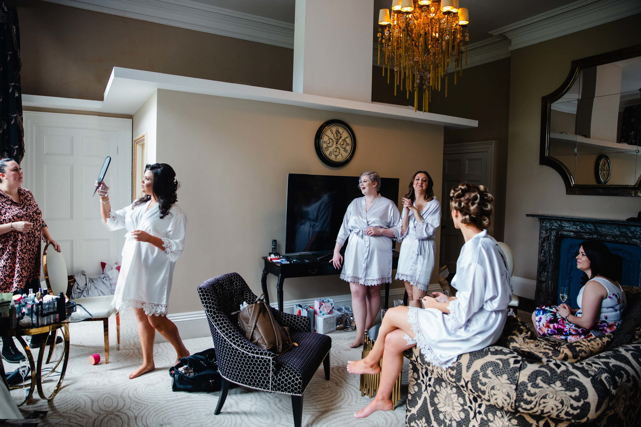 wide angle lens room photograph of bridal suite with bride getting ready
