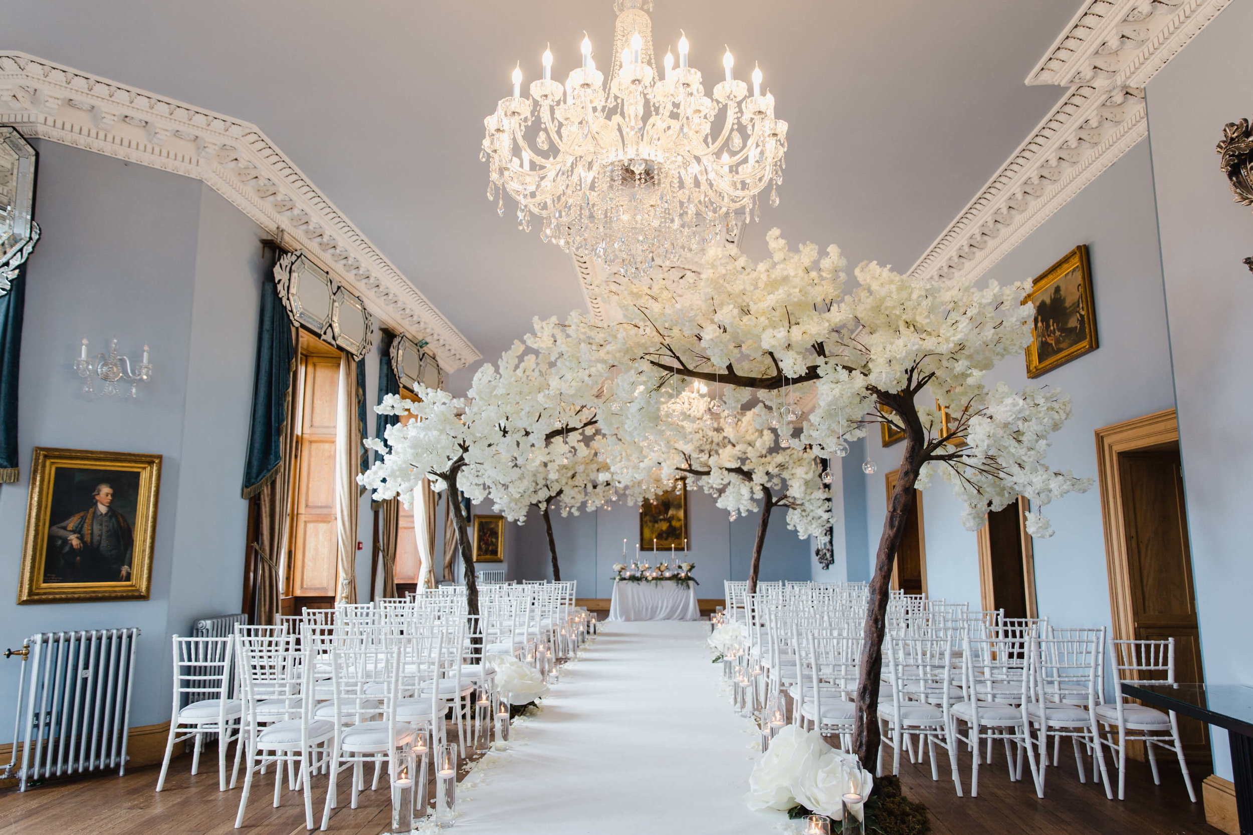 wedding ceremony aisle dressed with blossom trees by kelly louise floral artistry