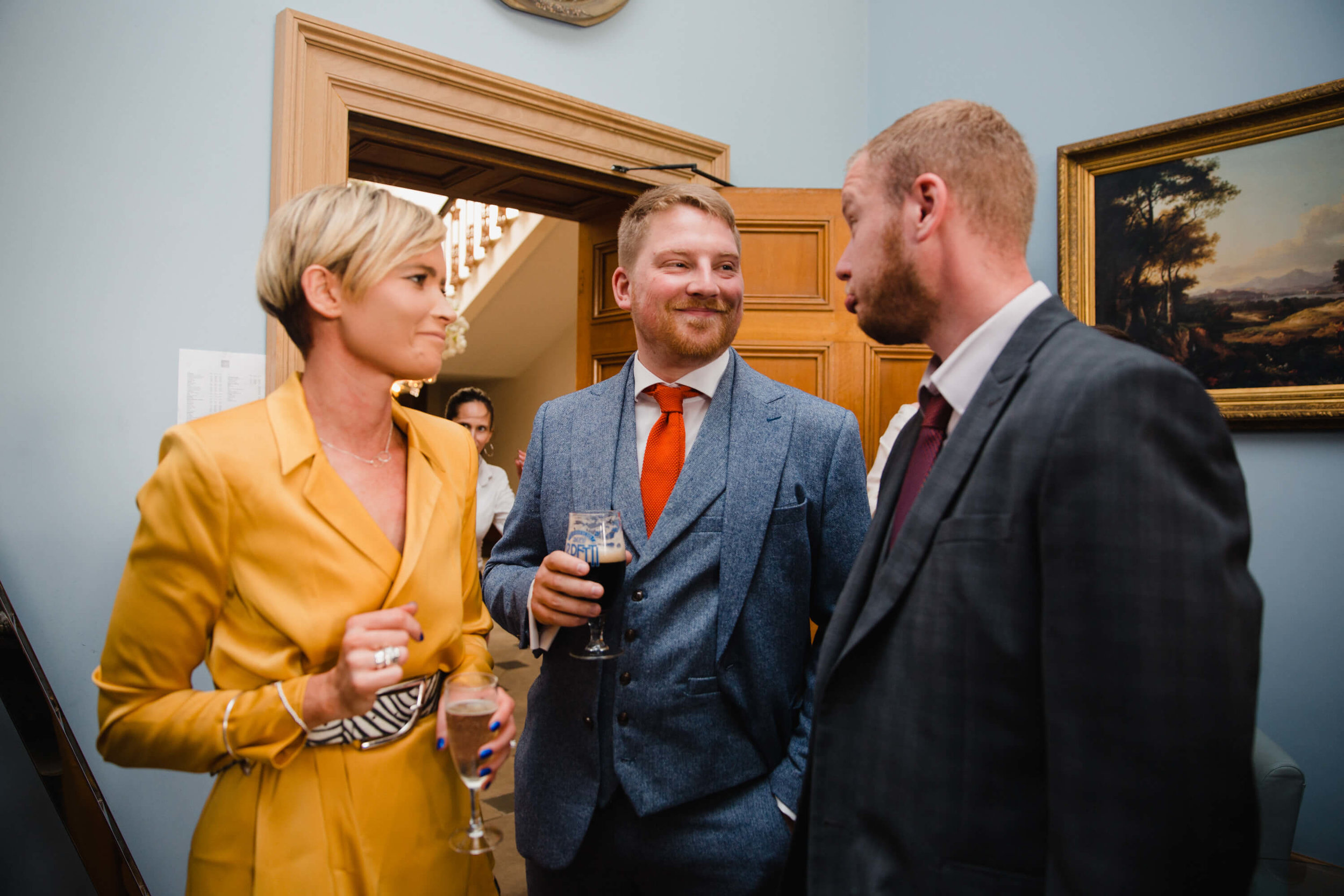 wedding guests enjoying drinks together at haigh hall
