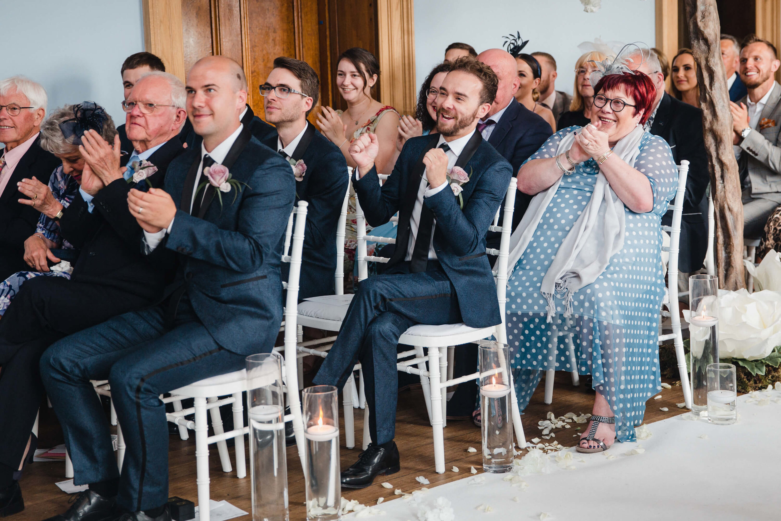 best man cheers for newlyweds at haigh hall