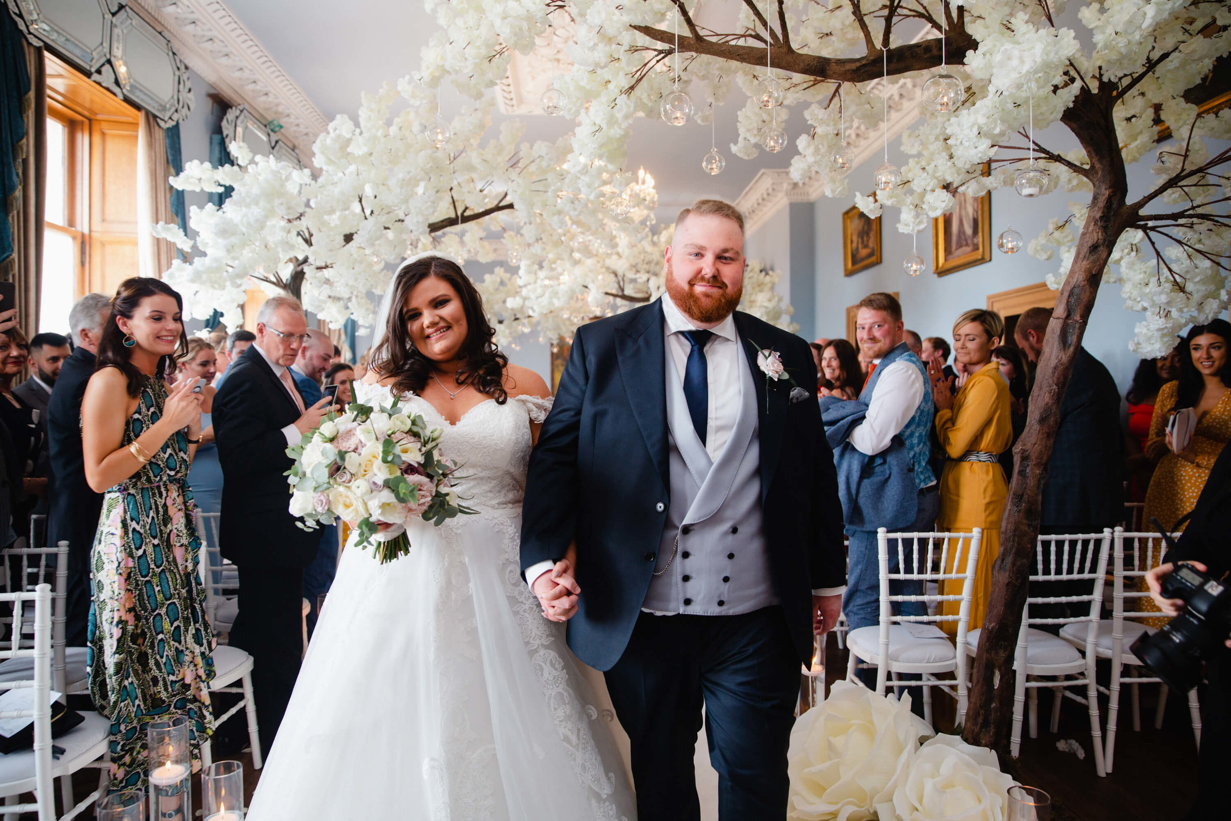 bride and groom with big smiles as wedding ceremony finishes